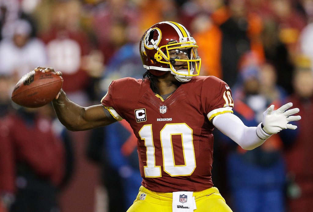 . LANDOVER, MD - DECEMBER 30:   Robert Griffin III #10 of the Washington Redskins looks ot pass against the Dallas Cowboys in the second quarter at FedExField on December 30, 2012 in Landover, Maryland.  (Photo by Rob Carr/Getty Images)
