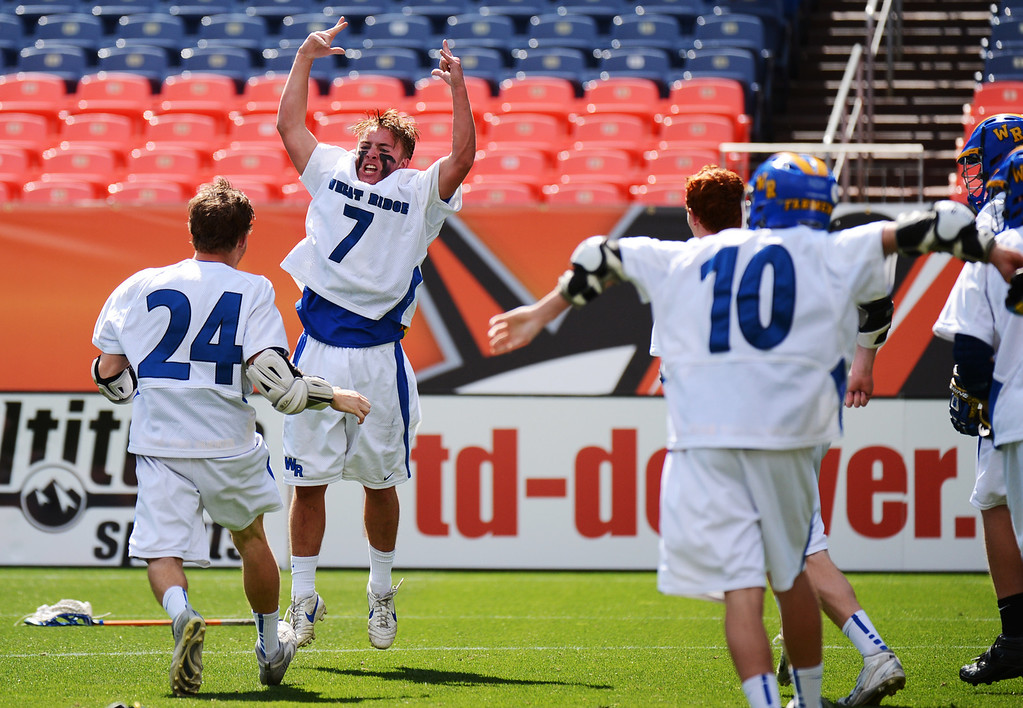 . DENVER, CO. - MAY 18 : Josh Kaufling (24), Jensen Makarov (7) and Wheat Ridge High School players celebrate winning of 4A Boy\'s Lacrosse Championship game against Air Academy High School at Sports Authority Field at Mile High Stadium. Denver, Colorado. May 18, 2013. Wheat Ridge won 14-2. (Photo By Hyoung Chang/The Denver Post)