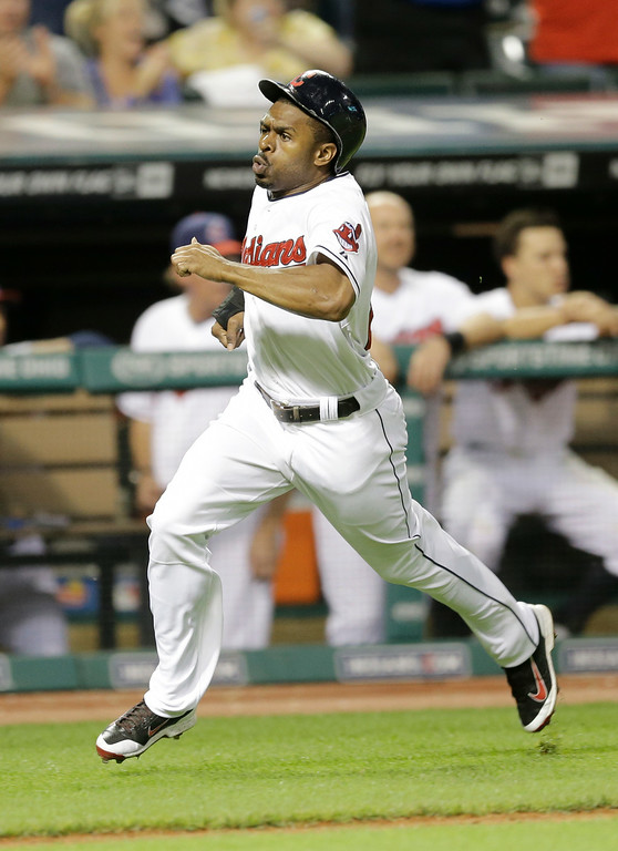 . Cleveland Indians\' Michael Bourn scores on an RBI-double by Jose Ramirez in the seventh inning of a baseball game against the Detroit Tigers, Wednesday, Sept. 3, 2014, in Cleveland. (AP Photo/Tony Dejak)
