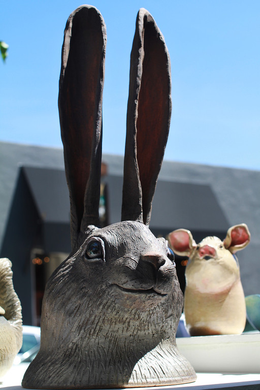 . A sculpted rabbit head is on display at the booth of artist Laddy Barnett at the 31st annual Sidewalk Fine Arts Festival on Santa Cruz Avenue in downtown Menlo Park on Friday, April 19, 2013. The festival has artworks including painting, jewelry, and sculpture. The festival started Friday and continues to Sunday. The festival is open today, Saturday, from 10 a.m. to 6 p.m. and Sunday from 10 am. to 5 p.m. For more information, visit pacificfinearts.com.  (Kirstina Sangsahachart/ Daily News)