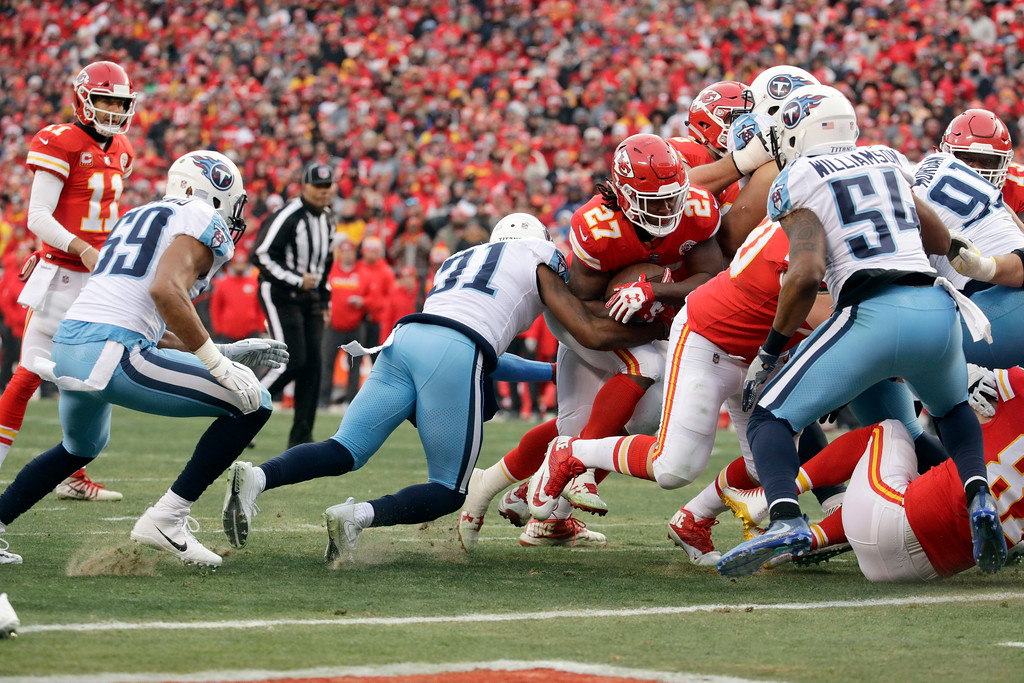 . Kansas City Chiefs running back Kareem Hunt (27) carries the ball for a one-yard touchdown during the first half of an NFL wild-card playoff football game against the Tennessee Titans, in Kansas City, Mo., Saturday, Jan. 6, 2018. (AP Photo/Charlie Riedel)