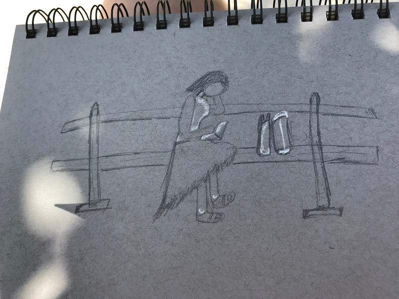 My simple sketch of a lady reading a book in the park