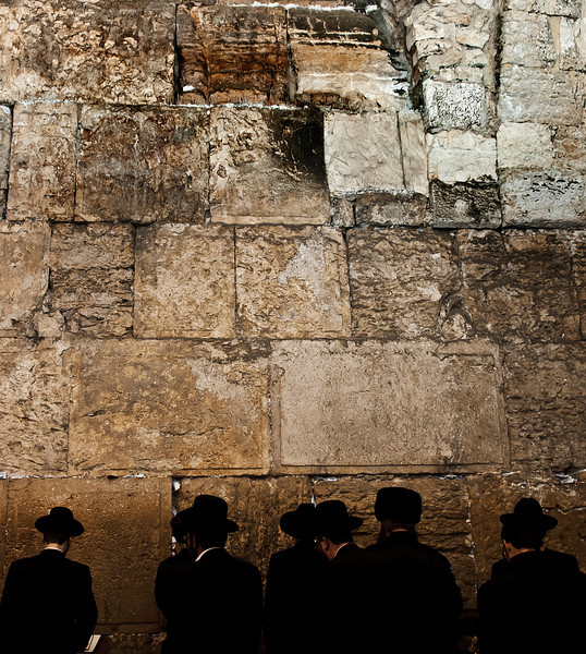 People praying at the wailing wall.  Jerusalem, Israel, 2012.