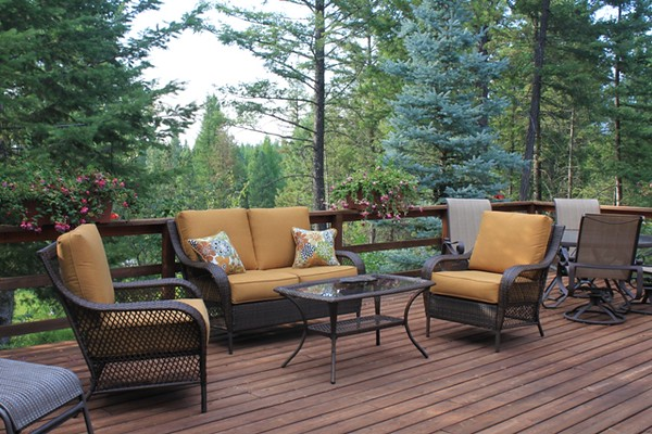 The deck at Dreamcatcher Lodge is perfect for reading or relaxing after a busy day in Glacier National Park.