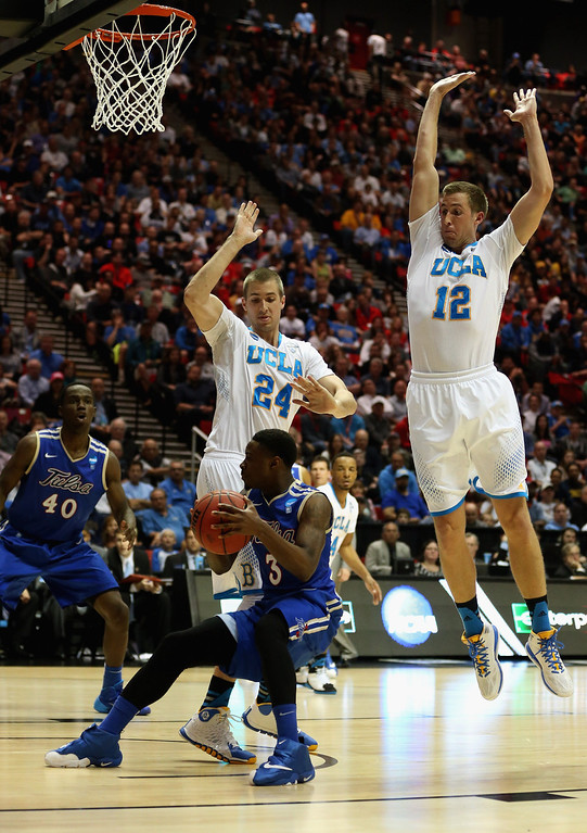 . David Wear #12 and Travis Wear #24 of the UCLA Bruins guard Stevie Repichowski #23 of the Tulsa Golden Hurricane during the second round of the 2014 NCAA Men\'s Basketball Tournament at Viejas Arena on March 21, 2014 in San Diego, California.  (Photo by Jeff Gross/Getty Images)