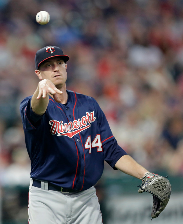 . Minnesota Twins starting pitcher Kyle Gibson throws out Cleveland Indians\' Erik Gonzalez at first base during the seventh inning of a baseball game Friday, June 15, 2018, in Cleveland. (AP Photo/Tony Dejak)