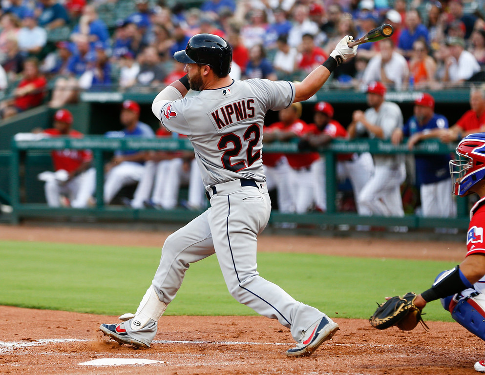 . Cleveland Indians\' Jason Kipnis (22) follows through on a two-run home run against the Texas Rangers during the second inning of a baseball game, Friday, July 20, 2018, in Arlington, Texas. (AP Photo/Jim Cowsert)