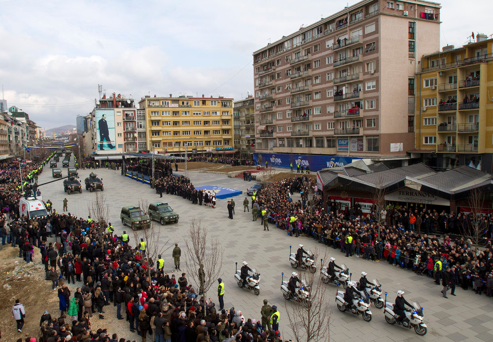 Description of . Kosovo Security Force and Kosovo police members parade in the center of Pristina marking the 5th anniversary since Kosovo seceded from Serbia on Sunday, Feb. 17, 2013. Serbia rejects Kosovo's independence. (AP Photo/Visar Kryeziu )