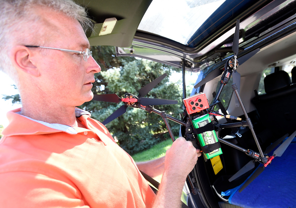 . LONGMONT, CO - AUGUST 9: Tim Haynie, of Arbor Drone, prepares the craft for flight. The drone has five cameras to detect different wavelengths of light. Arbor Drone LLC and Spectrabotics LLC,  collected data using drone flights over northwest Longmont on August 9, 2018, to study and monitor trees affected by Emerald Ash Borer (EAB).  Longmont will be one of the last EAB detection flights for 2018 for the team. Drone flights in urban areas to study tree pests have never been conducted at this scale. (Photo by Cliff Grassmick/Staff Photographer)
