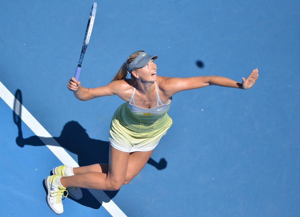 . Russia\'s Maria Sharapova serves against China\'s Li Na during their women\'s singles semi-final match on day 11 of the Australian Open tennis tournament in Melbourne on January 24, 2013.  PETER PARKS/AFP/Getty Images