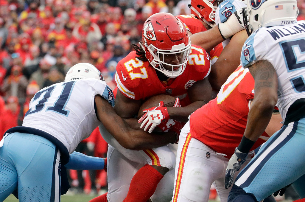 . Kansas City Chiefs running back Kareem Hunt (27) carries the ball over the goal line for a one-yard touchdown run during the first half of an NFL wild-card playoff football game against the Tennessee Titans in Kansas City, Mo., Saturday, Jan. 6, 2018. (AP Photo/Charlie Riedel)