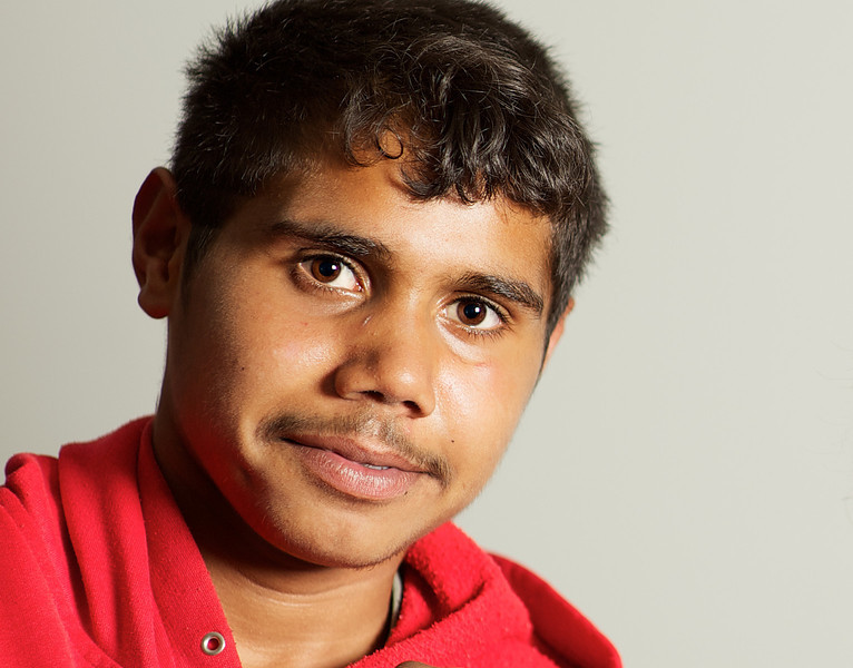 Teenage Aboriginal Boy  with a Red Top