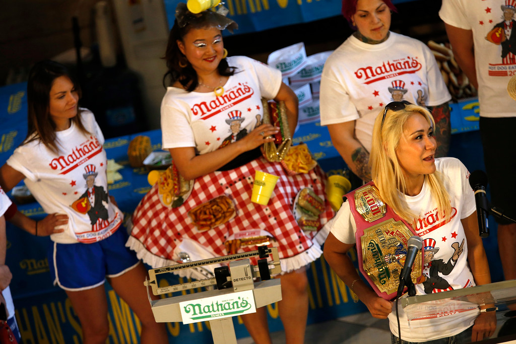 . The woman\'s hot dog-eating champion Miki Sudo of Las Vegas talks about the upcoming 2017 contest during the weight in for the Nathan\'s Famous Hotdog eating contest Monday, July 3, 2017, in Brooklyn, New York. (AP Photo/Michael Noble)
