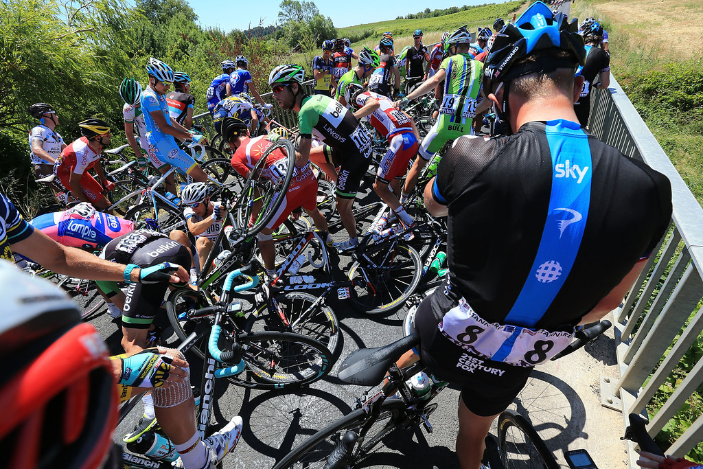 . MONTPELLIER, FRANCE - JULY 05: Riders are involved in a crash during stage seven of the 2013 Tour de France, a 205.5KM road stage from Montpellier to Albi, on July 5, 2013 in Montpellier, France.  (Photo by Doug Pensinger/Getty Images)