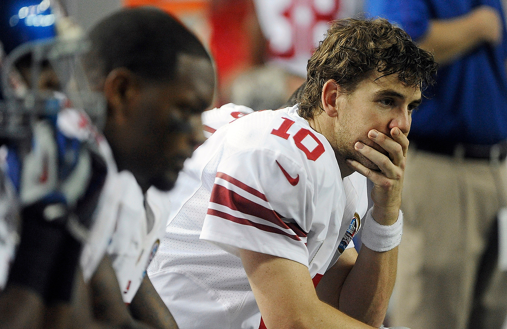 Description of . New York Giants quarterback Eli Manning (10) sits on the bench during the second half of an NFL football game against the Atlanta Falcons, Sunday, Dec. 16, 2012, in Atlanta. (AP Photo/John Amis)