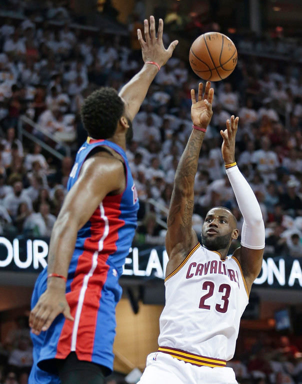 . Cleveland Cavaliers\' LeBron James (23) shoots over Detroit Pistons\' Andre Drummond (0) in the first half in Game 1 of a first-round NBA basketball playoff series, Sunday, April 17, 2016, in Cleveland. (AP Photo/Tony Dejak)