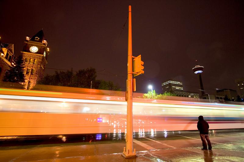 Pedestrian waiting for LRT to pass
