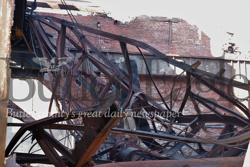 Wreckage from the collapsed roof and interior of the old glass factory that caught fire Friday night. Seb Foltz/Butler Eagle