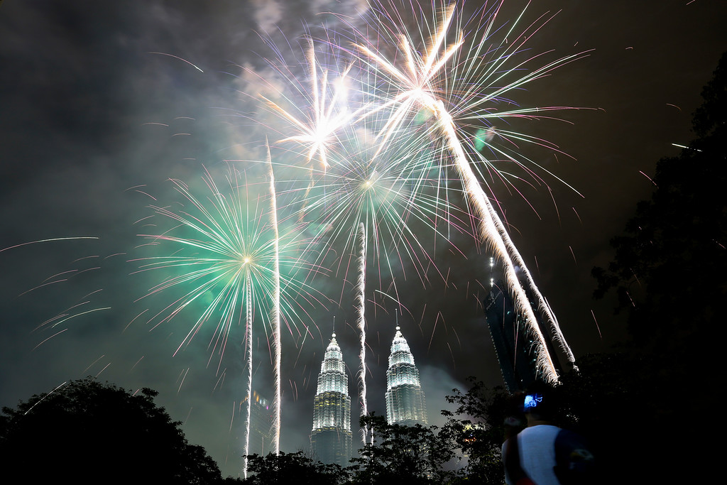 . Fireworks explode  in front of Malaysia\'s landmark building, the Petronas Twin Towers, during the New Year\'s celebration in Kuala Lumpur, Malaysia, Monday, Jan. 1, 2018. (AP Photo/Sadiq Asyraf)