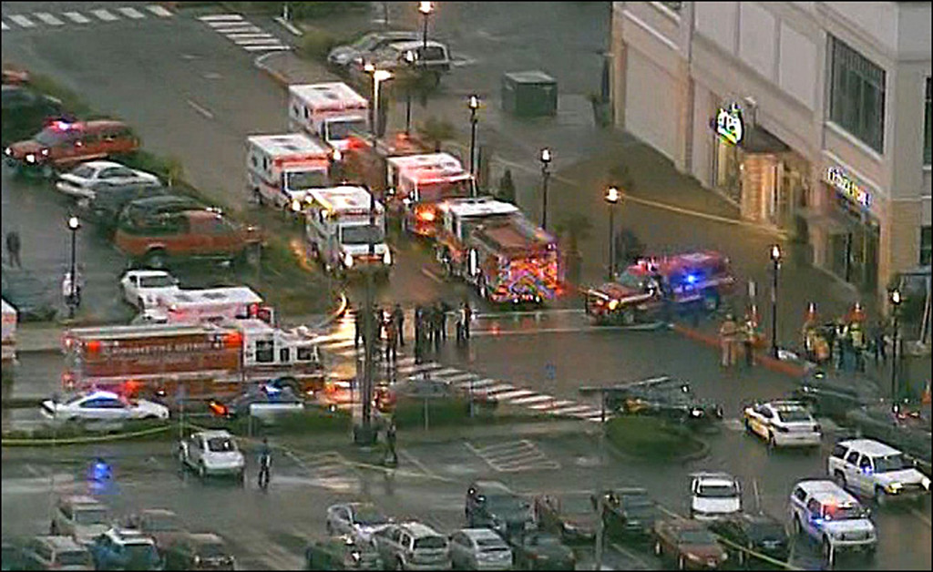 . This still image from video courtesy of KATU.COM shows emergency vehicles after a shooting December 11, 2012 outside the Clackamas Town Center south of Portland, Oregon.   Two people were killed  when a gunman wearing body armor opened fire at a mall in the western US state of Oregon, witnesses and local media reported.  At least one other person was shot in Clackamas, south of Portland, according to The Oregonian newspaper, reporting a man brandishing a semiautomatic rifle near a branch of Macy\'s department store.     AFP PHOTO / KATU.COM