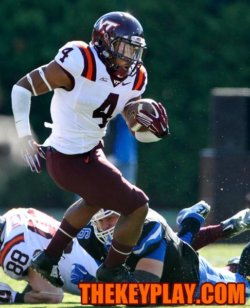Virginia Tech running back J.C. Coleman (4) rushes past a Duke defender. (Michael Shroyer/ Thekeyplay.com)