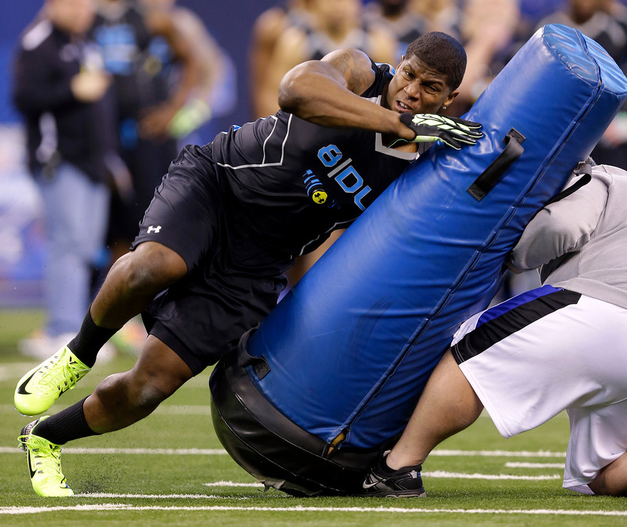 . Missouri defensive lineman Kony Ealy runs a drill at the NFL football scouting combine in Indianapolis, Monday, Feb. 24, 2014. (AP Photo/Michael Conroy)