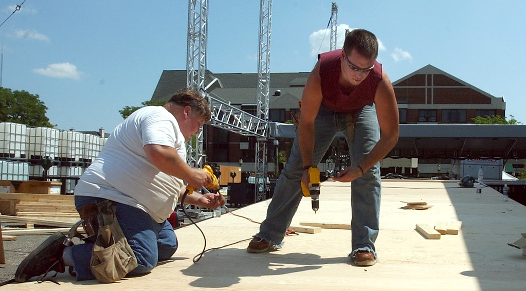 . Fritz Seelmann,left, of Harriston Twp. along with partner Bo Marasco of Chesterfield Twp. co-owners of CBSM & Associates work on the main ramp to the stage area for the Ford Exhibit located near Shane Park in downtown Birmingham for this weekends Dream Cruise.