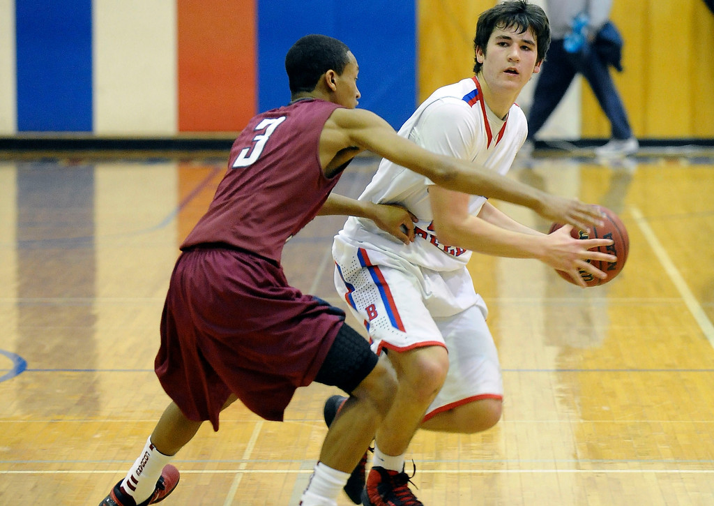 . GREENWOOD VILLAGE, CO. - FEBRUARY 6: Griffin Parr of Cherry Creek looks for an opening to pass the ball to Sam Stoveall in the second half Wednesday night at Cherry Creek High School. (Photo by Steve Nehf, The Denver Post)