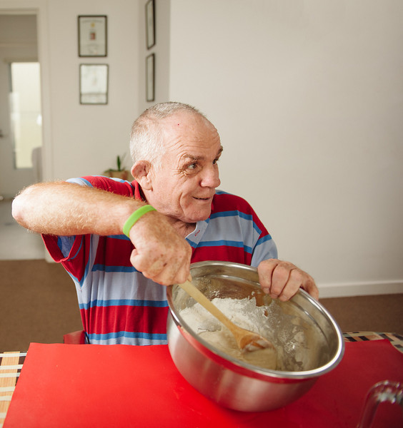 Man with an Intellectual Disability mixing Batter