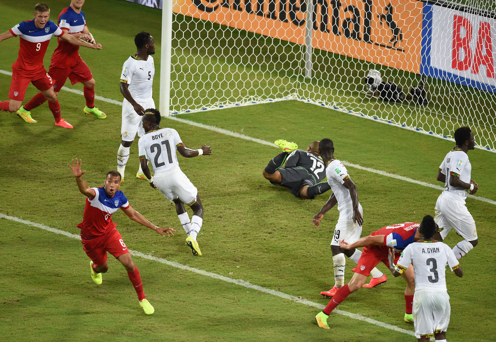 Description of . US defender John Brooks (L) celebrates after scoring during a Group G football match between Ghana and US at the Dunas Arena in Natal during the 2014 FIFA World Cup on June 16, 2014.  AFP PHOTO / JAVIER SORIANOJAVIER SORIANO/AFP/Getty Images