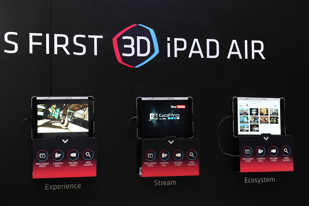. iPad Airs are displayed with EyeFly 3D screen protector film to create a 3D effect without the need for special glasses, at the 2014 International CES in Las Vegas, Nevada, January 8, 2014.  The iPad Air 3D will be available this month and is priced at USD $26.95.  The consumer electronics show, one of the largest in the world, runs from Jan 7-10. AFP PHOTO / ROBYN BECK/AFP/Getty Images