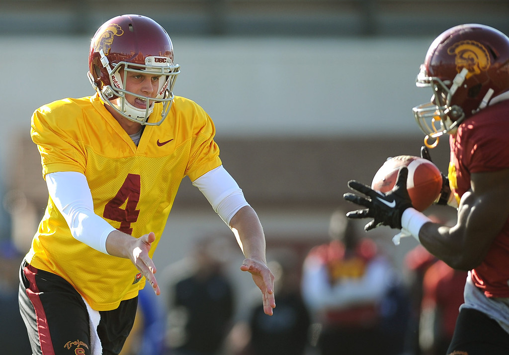 . USC quarterback Max Browne dishes off the ball during spring practice at USC Monday, April 1, 2014. (Andy Holzman/Los Angeles Daily News)