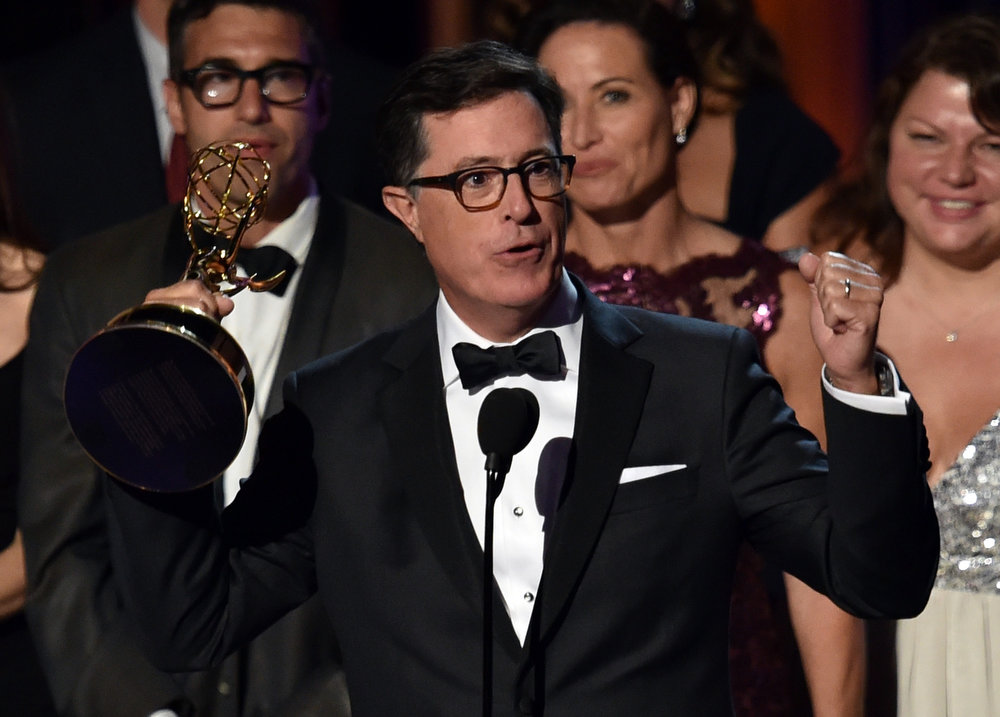 . TV personality Stephen Colbert accepts Outstanding Variety Series for \'The Colbert Report\' onstage at the 66th Annual Primetime Emmy Awards held at Nokia Theatre L.A. Live on August 25, 2014 in Los Angeles, California.  (Photo by Kevin Winter/Getty Images)