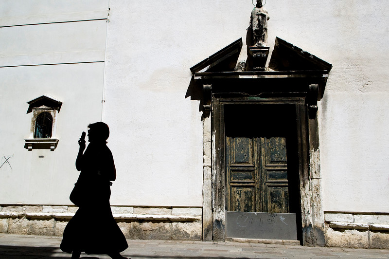 Woman walking and calling with her telefonino or mobile, Venice, Italy