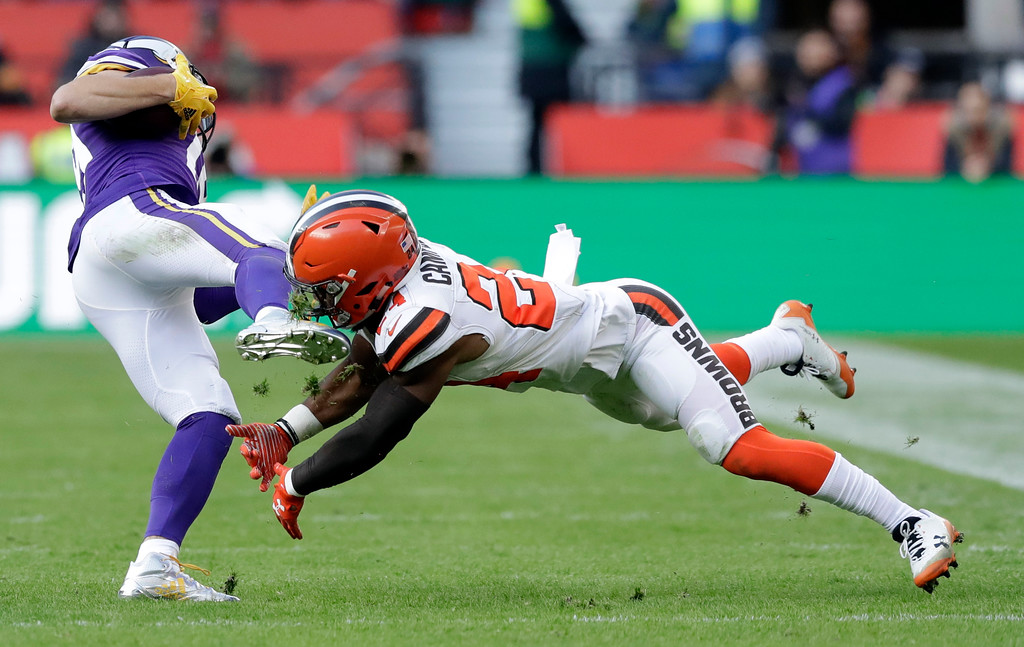 . Cleveland Browns Ibraheim Campbell, right, takes a boot to the face as he tries to make a tackle during the first half of an NFL football game against Minnesota Vikings at Twickenham Stadium in London, Sunday Oct. 29, 2017. (AP Photo/Matt Dunham)