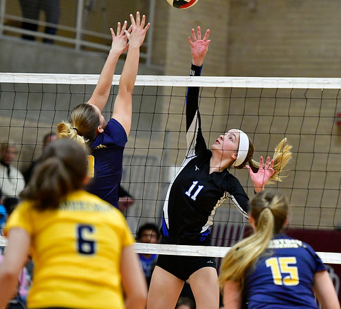 11/14/2018 Mike Orazzi | Staff Bristol Eastern's Ryley Plourde (11) and Woodstock Academy's Katherine Papp (18)during the Class L Semifinal State Girls Volleyball Tournament held at Windsor High School Wednesday night.