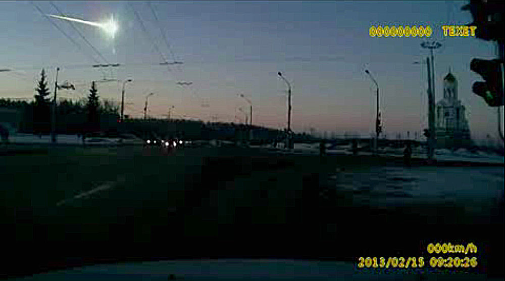 Description of . In this frame grab made from dashboard camera video, a meteor, upper left, streaks through the sky over Chelyabinsk, about 1500 kilometers (930 miles) east of Moscow, Friday, Feb. 15, 2013. With a blinding flash and a booming shock wave, the meteor blazed across the western Siberian sky Friday and exploded with the force of 20 atomic bombs, injuring more than 1,000 people as it blasted out windows and spread panic in a city of 1 million. (AP Photo/AP Video)