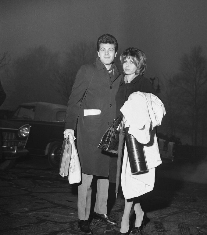 . Nancy Sinatra, daughter of famous singer and movie actor Frank, is shown outside their hotel on arrival in Milan with her husband Tommy Sands, Jan. 24, 1962. They came from Paris and are going to take part in a TV show for the Italian TV network.  (AP Photo)
