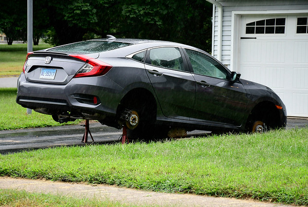 9/11/2018 Mike Orazzi | Staff A car without wheels on Ashley Road in Bristol Tuesday.