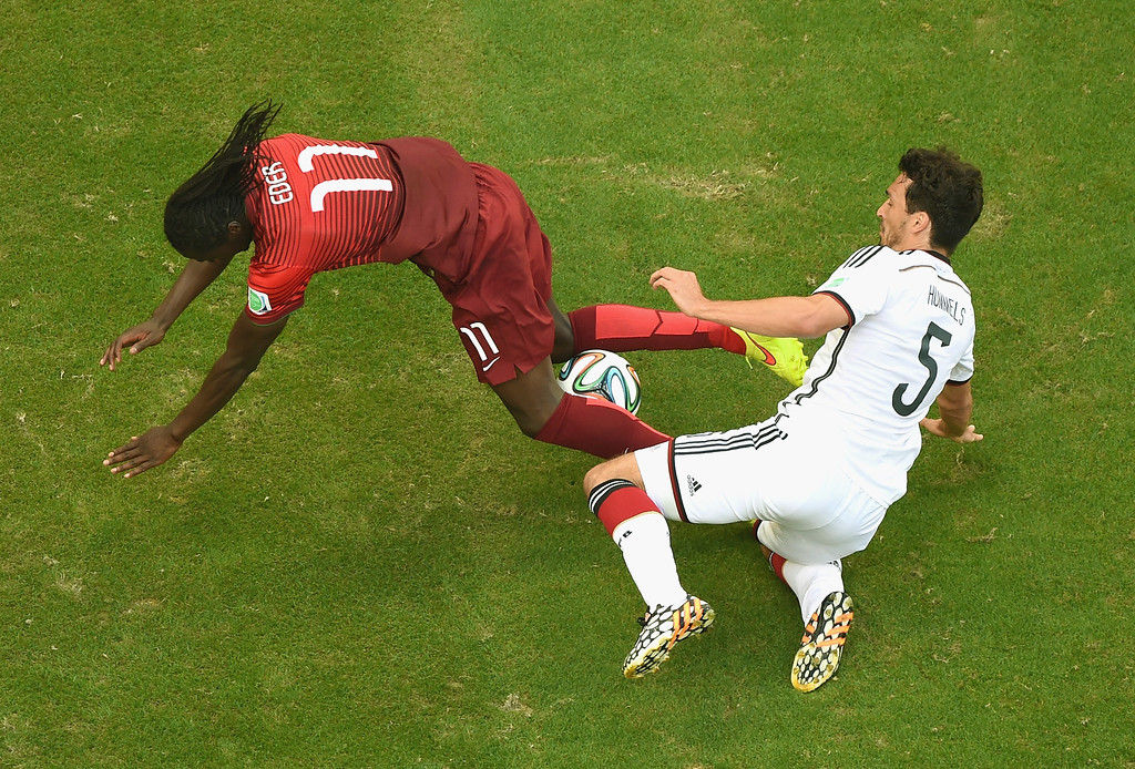 . Eder of Portugal and Mats Hummels of Germany battle for the ball during the 2014 FIFA World Cup Brazil Group G match between Germany and Portugal at Arena Fonte Nova on June 16, 2014 in Salvador, Brazil.  (Photo by Francois Xavier Marit - Pool/Getty Images)
