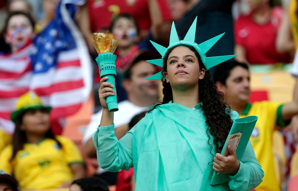 . A United States supporter dressed as the Statue of Liberty waits for the start of the group G World Cup soccer match between the United States and Portugal at the Arena da Amazonia in Manaus, Brazil, Sunday, June 22, 2014. (AP Photo/Marcio Jose Sanchez)