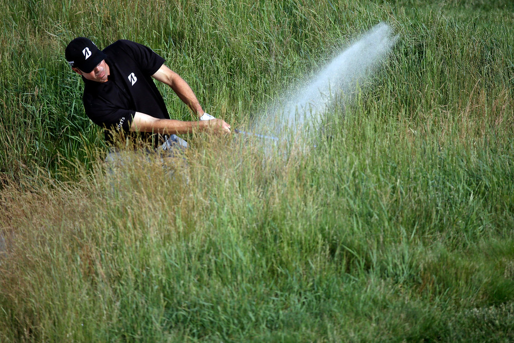 . Matt Kuchar hits out of a bunker on the sixth hole during the second round of the U.S. Open golf tournament at Merion Golf Club, Friday, June 14, 2013, in Ardmore, Pa. (AP Photo/Morry Gash)