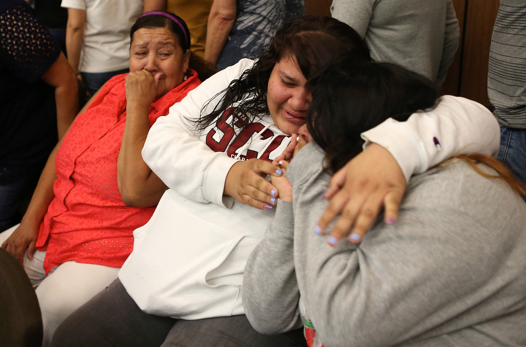 . Family members of Mark Estrada, from left, aunt Carmen Lopez, cousin Sofia Lopez, 14, and sister Vanesa Estrada, 15, react following his arraignment hearing at the Hayward Hall of Justice in Hayward, Calif., on Friday, July 24, 2015. Mark Estrada is accused of fatally shooting Hayward Police Sgt. Scott Lunger. (Anda Chu/Bay Area News Group)