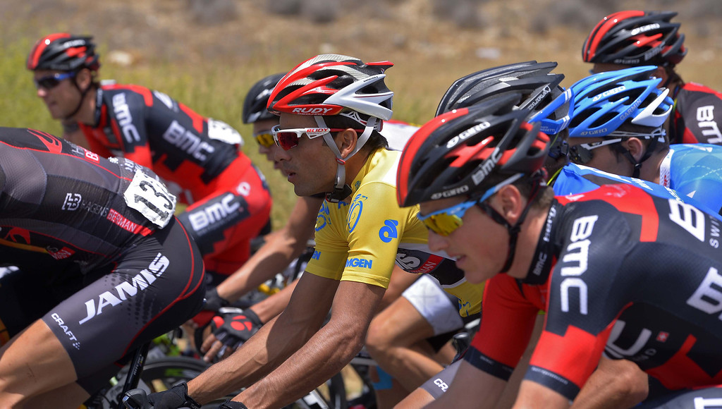 . Race leader Janier Acevedo, in the gold jersey, of Colombia, rides with the peloton during the fourth stage of the Tour of California cycling event, Wednesday, May 15, 2013, in Fillmore, Calif.  (AP Photo/Mark J. Terrill)
