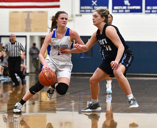 2/18/2020 Mike Orazzi | StaffrBristol Eastern's Ciara Collins (11) and East Catholic's Nyasia Dogans (11) during a 57-52 Eastern overtime win in Bristol Tuesday afternoon.