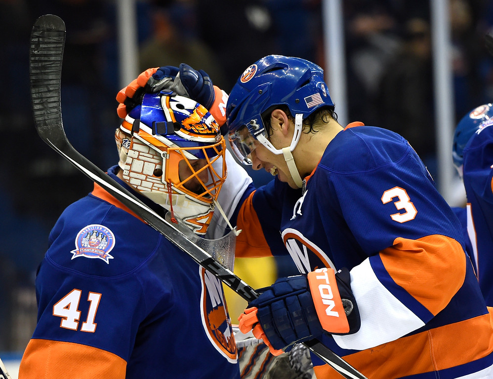 . New York Islanders defenseman Travis Hamonic (3) congratulates goalie Jaroslav Halak (41) after the Islanders beat the Colorado Avalanche 6-0 in an NHL hockey game at Nassau Coliseum on Tuesday, Nov. 11, 2014, in Uniondale, N.Y. Harmonic scored during the win. (AP Photo/Kathy Kmonicek)