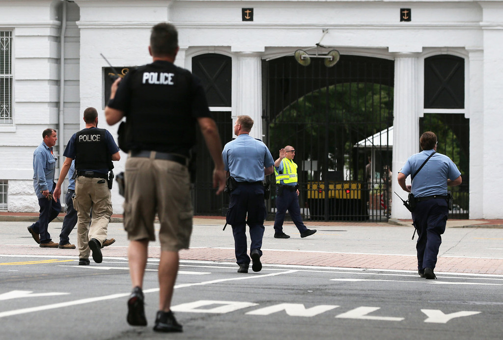 . Law enforcement personnel respond to a reported shooting at an entrance to the Washington Navy Yard September 16, 2013 in Washington, DC. According to the latest news report several people were shot with the shooter still possibly active.   (Photo by Alex Wong/Getty Images)