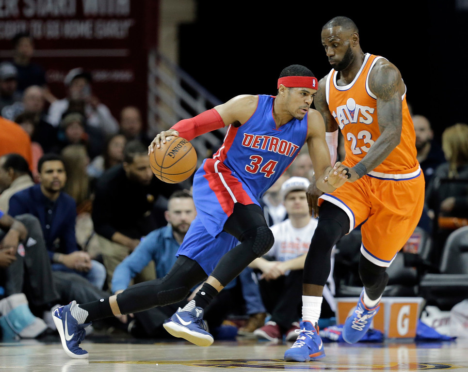 . Detroit Pistons\' Tobias Harris (34) drives against Cleveland Cavaliers\' LeBron James (23) in the first half of an NBA basketball game, Tuesday, March 14, 2017, in Cleveland. (AP Photo/Tony Dejak)