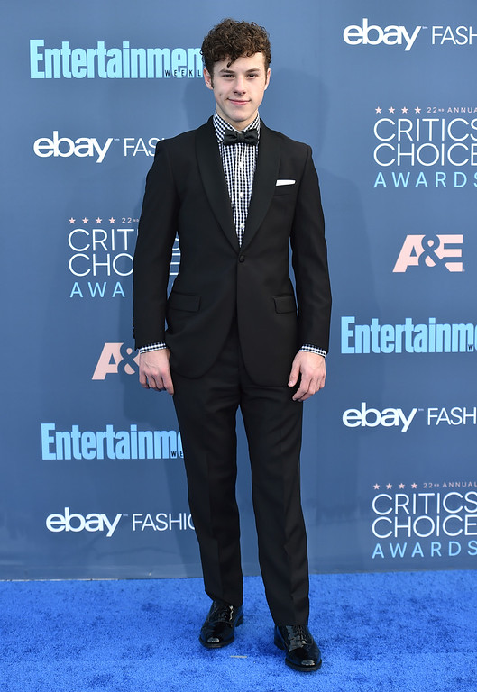 . Nolan Gould arrives at the 22nd annual Critics\' Choice Awards at the Barker Hangar on Sunday, Dec. 11, 2016, in Santa Monica, Calif. (Photo by Jordan Strauss/Invision/AP)