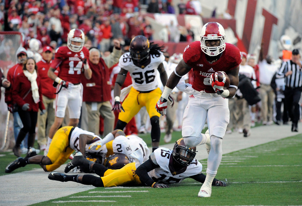 . Indiana\'s Tevin Coleman, right, runs for a touchdown as Minnesota\'s Marcus Jones (15) watches during the second half of NCAA college football game in Bloomington, Ind., Saturday, Nov. 2, 2013. Minnesota won 42-39. (AP Photo/Alan Petersime)